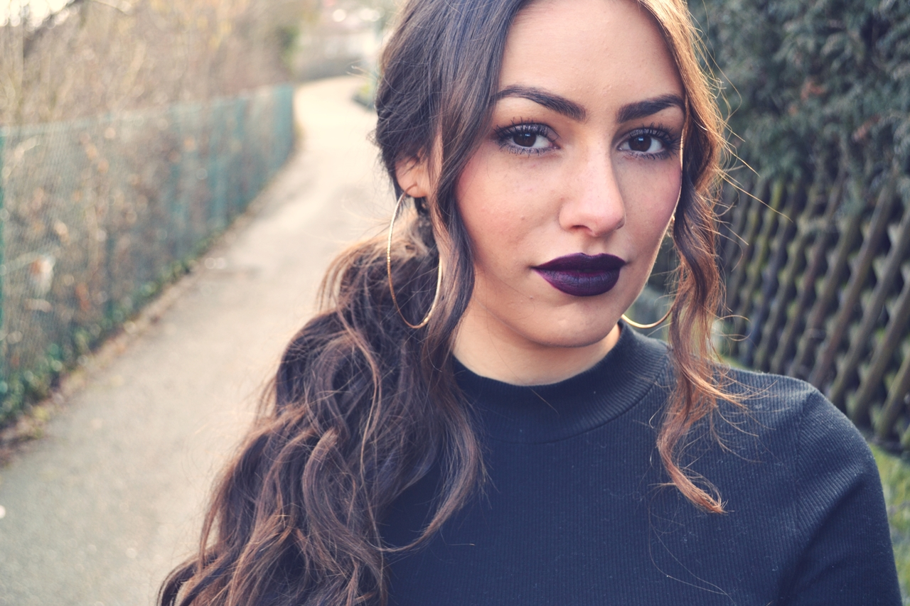 black sweater dark lipstick
